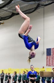 Sartell's Emma Schwartz competes on the beam Thursday, Jan. 3, at the Sauk Rapids-Rice High School.