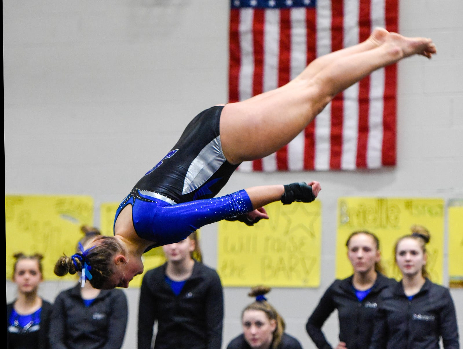 Sartell's Brenna Chisholm does a flip during her floor routine Thursday, Jan. 3, at the Sauk Rapids-Rice High School.