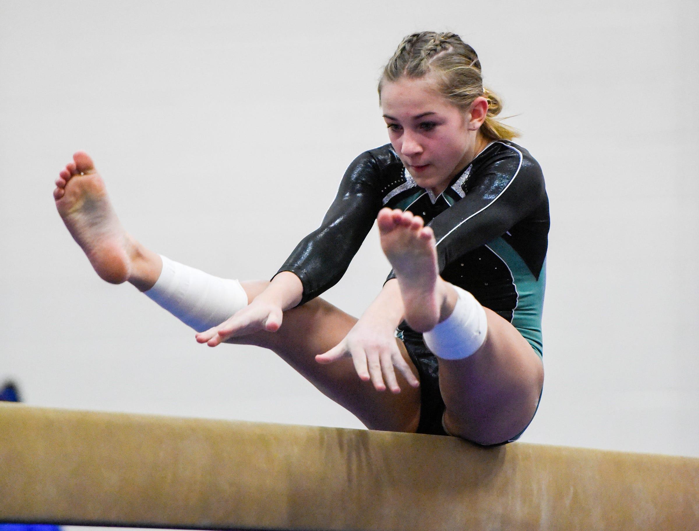 Sauk Rapids' Liberty Kosloski competes on the beam Thursday, Jan. 3, at the Sauk Rapids-Rice High School.
