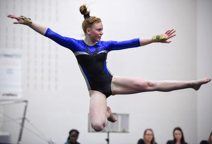 Sartell's Marlys Michaud competes on the floor Thursday, Jan. 3, at the Sauk Rapids-Rice High School.