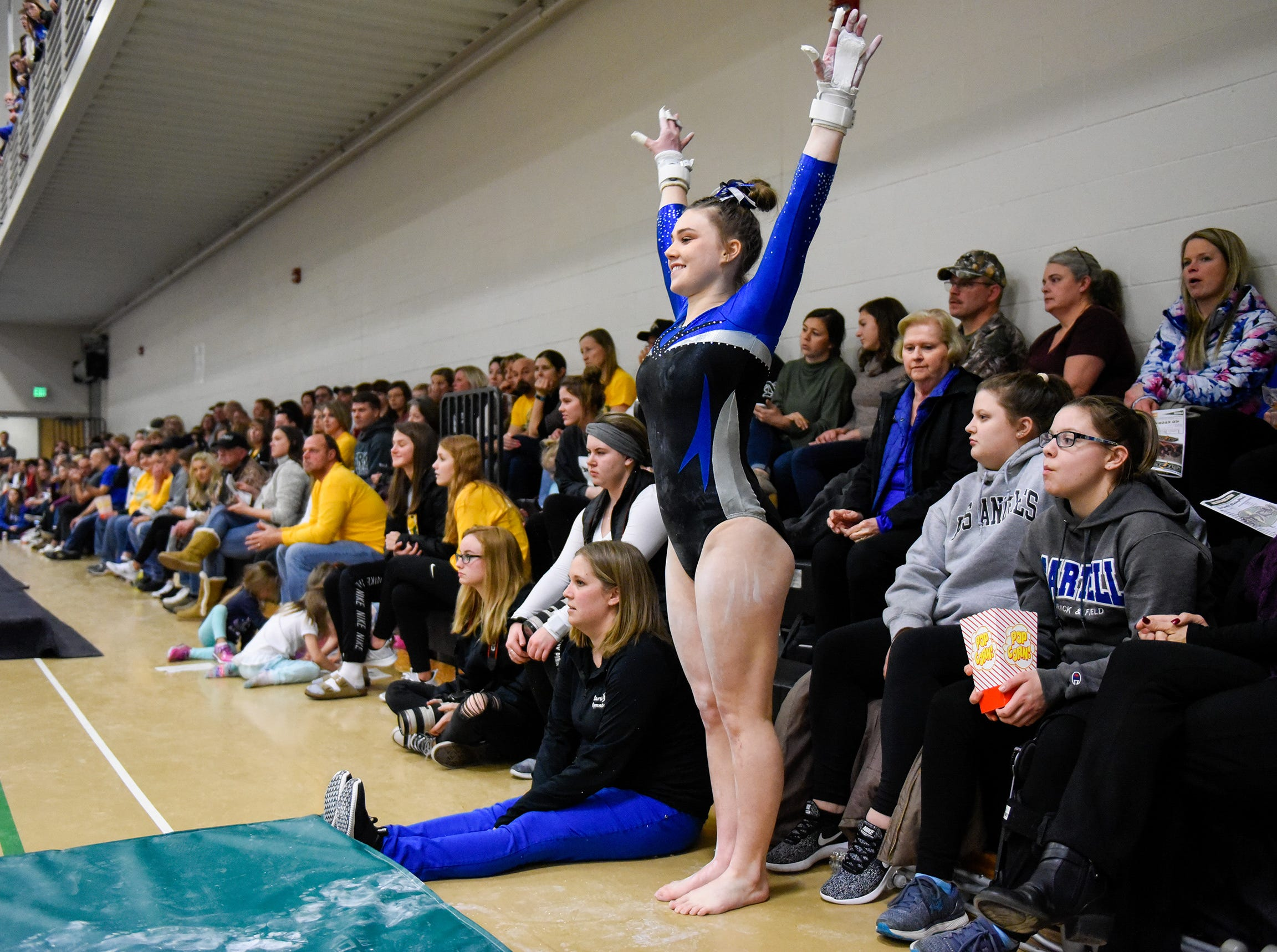 Sartell's Abigail Weber starts her bar routine for the crowd Thursday, Jan. 3, at the Sauk Rapids-Rice High School.
