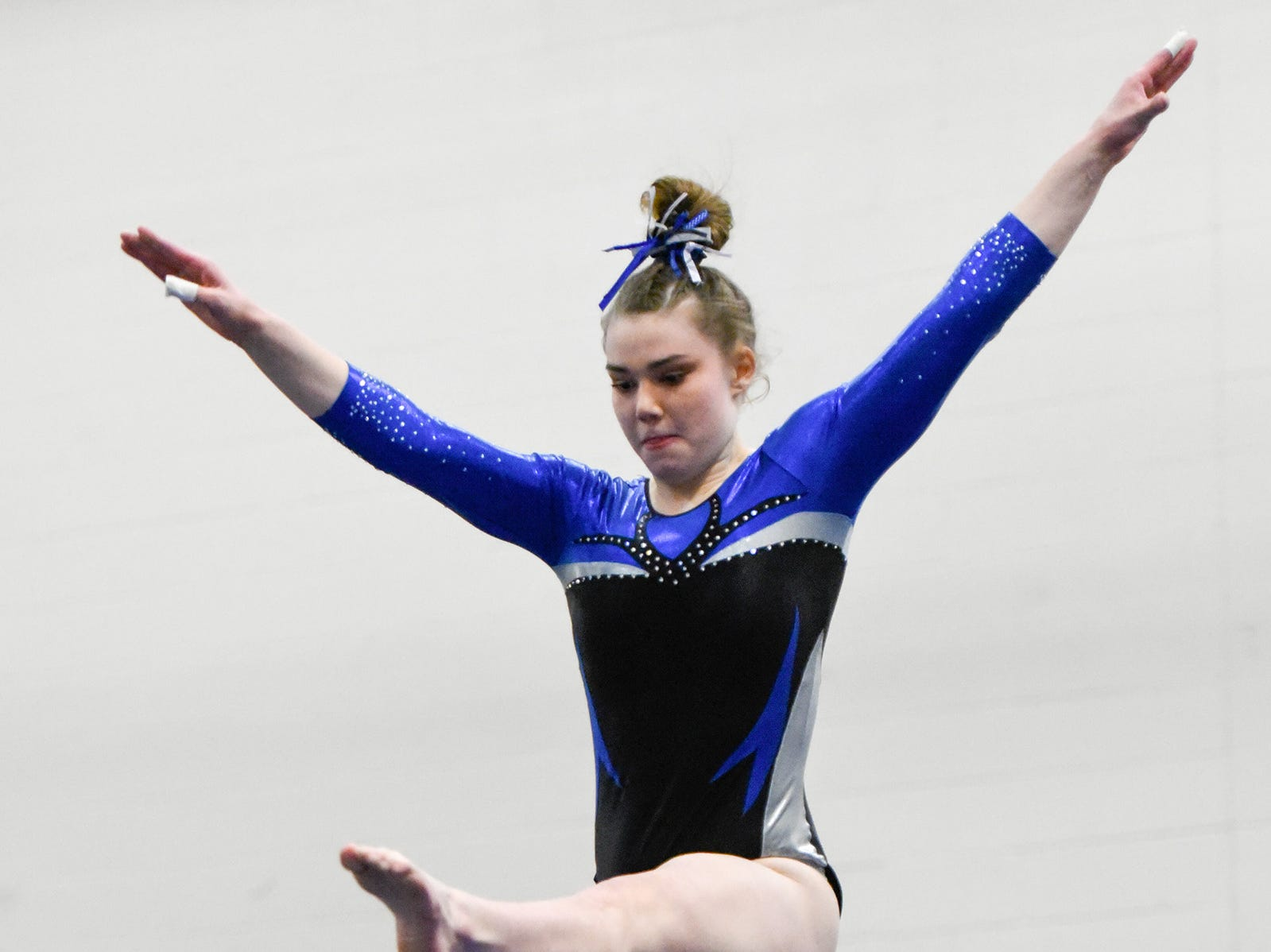 Sartell's Abigail Weber competes on the beam Thursday, Jan. 3, at the Sauk Rapids-Rice High School.
