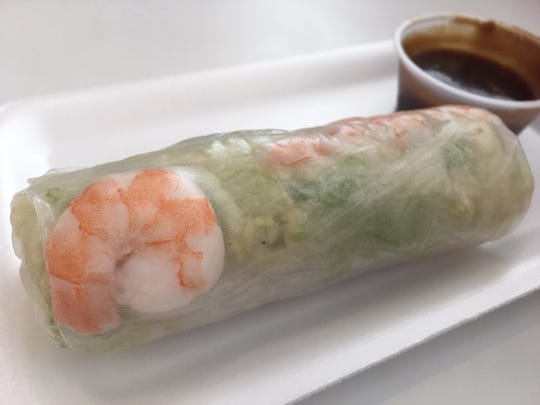 A shrimp spring roll with a sweet dipping sauce at Vietnam Bread & Roll.