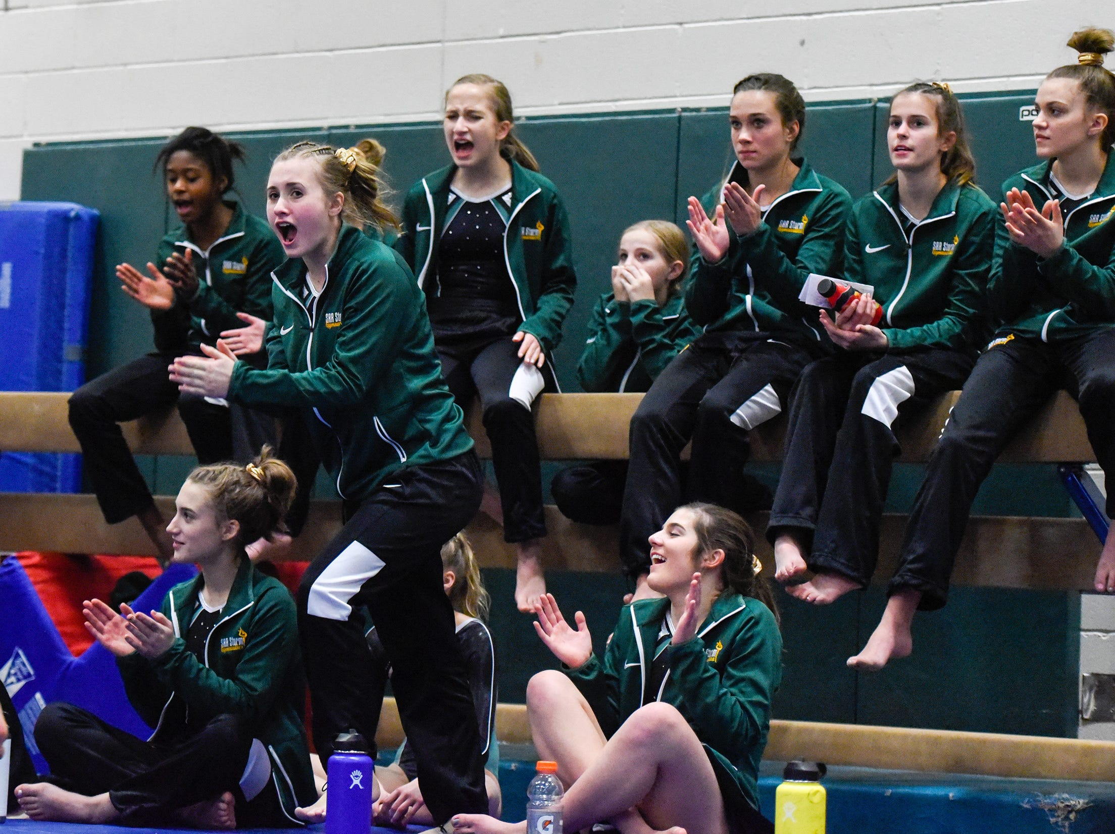 Sauk Rapids gymnasts cheer for a teammate on the beam Thursday, Jan. 3, at the Sauk Rapids-Rice High School.