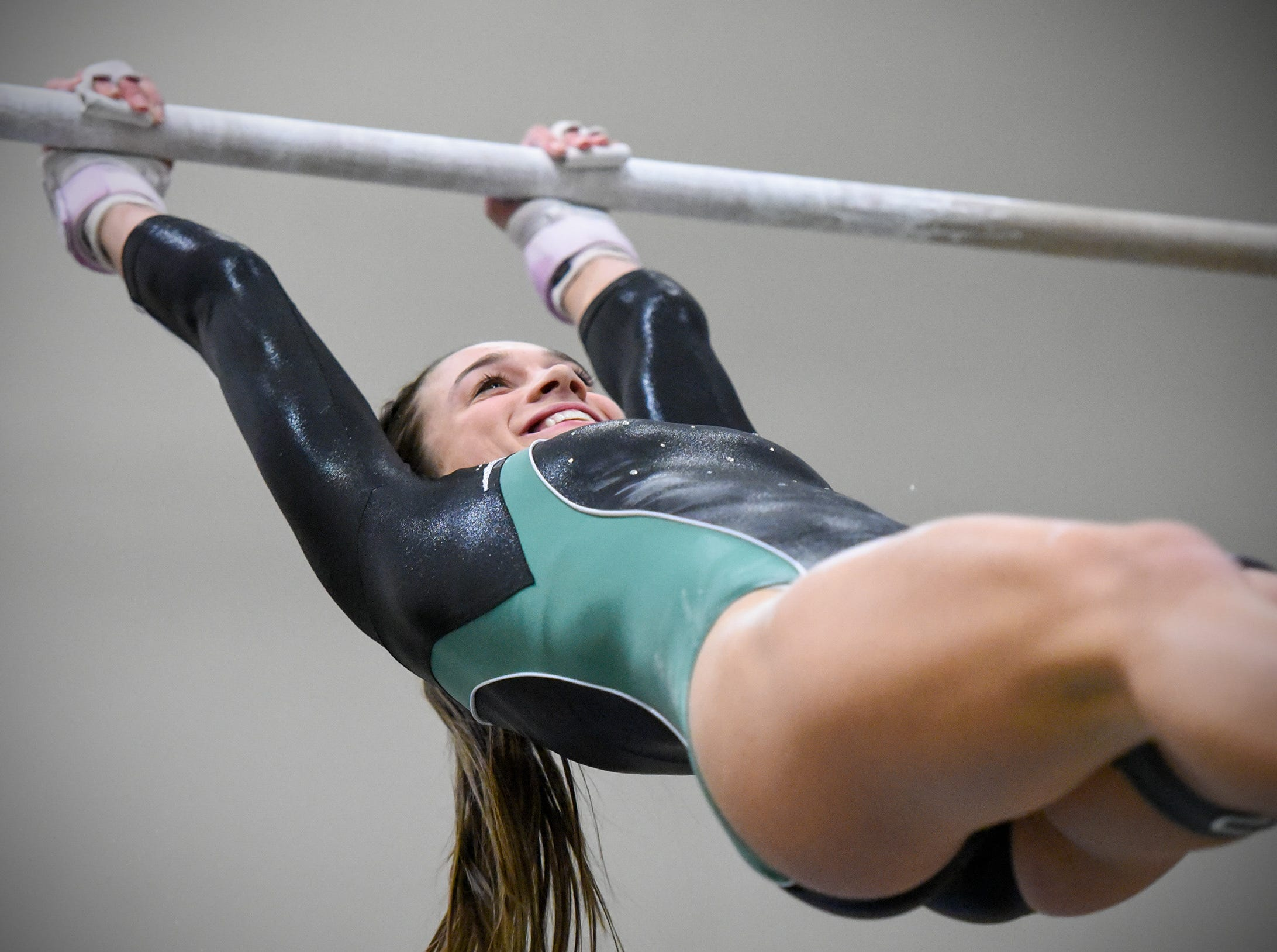 Sauk Rapids' Anna Walz competes on the bars Thursday, Jan. 3, at the Sauk Rapids-Rice High School. Sartell topped Sauk Rapids in the meet, 145.025 to 134.35. Go online to www.sctimes.com/sports to see more photos from the event.