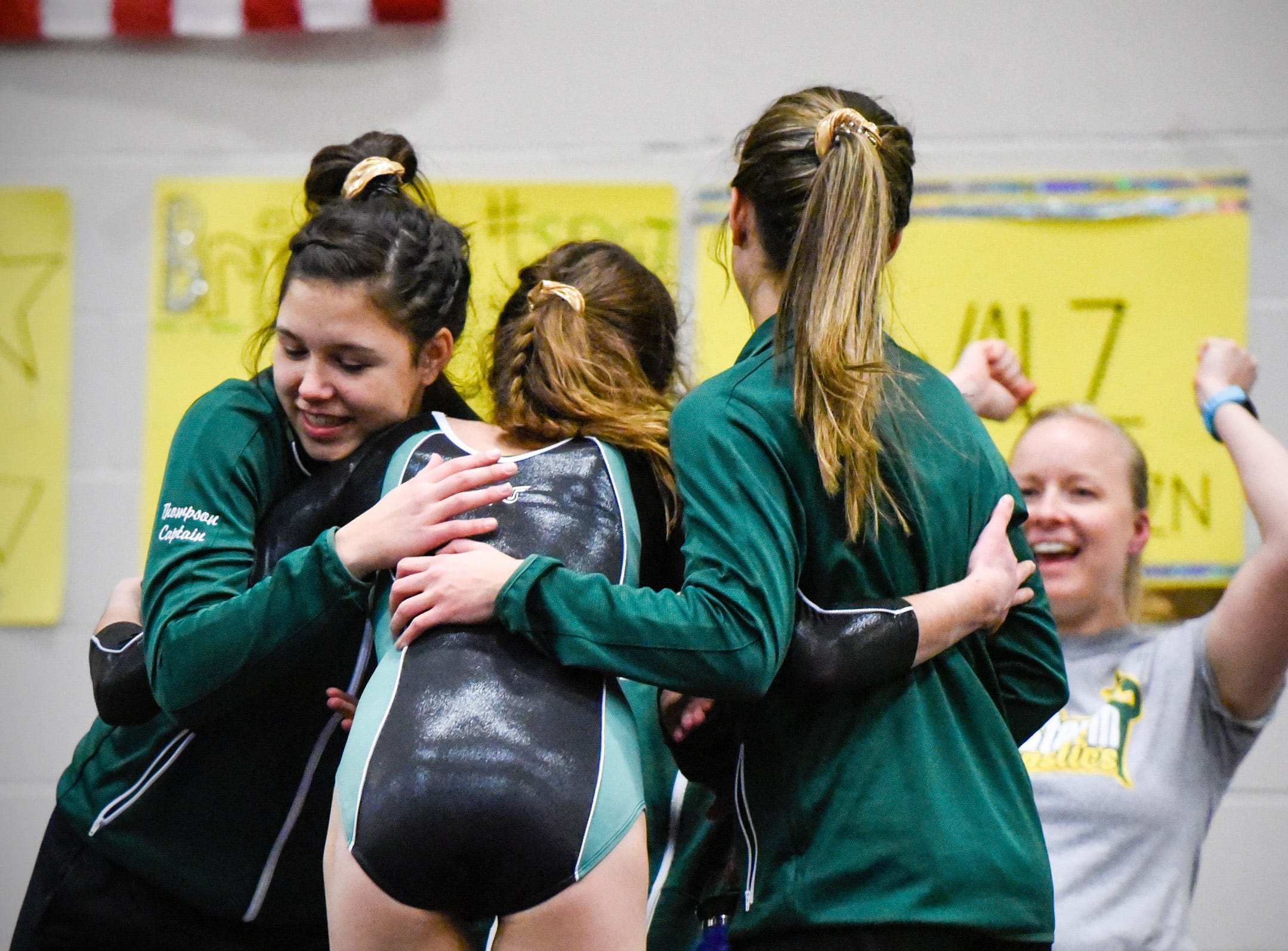 Sauk Rapids' Justus Floren is met by teammates after her floor routine Thursday, Jan. 3, at the Sauk Rapids-Rice High School.