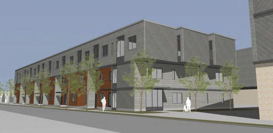 A rendering of what the three-story apartment complex for the proposed Lullabye development might look like.
