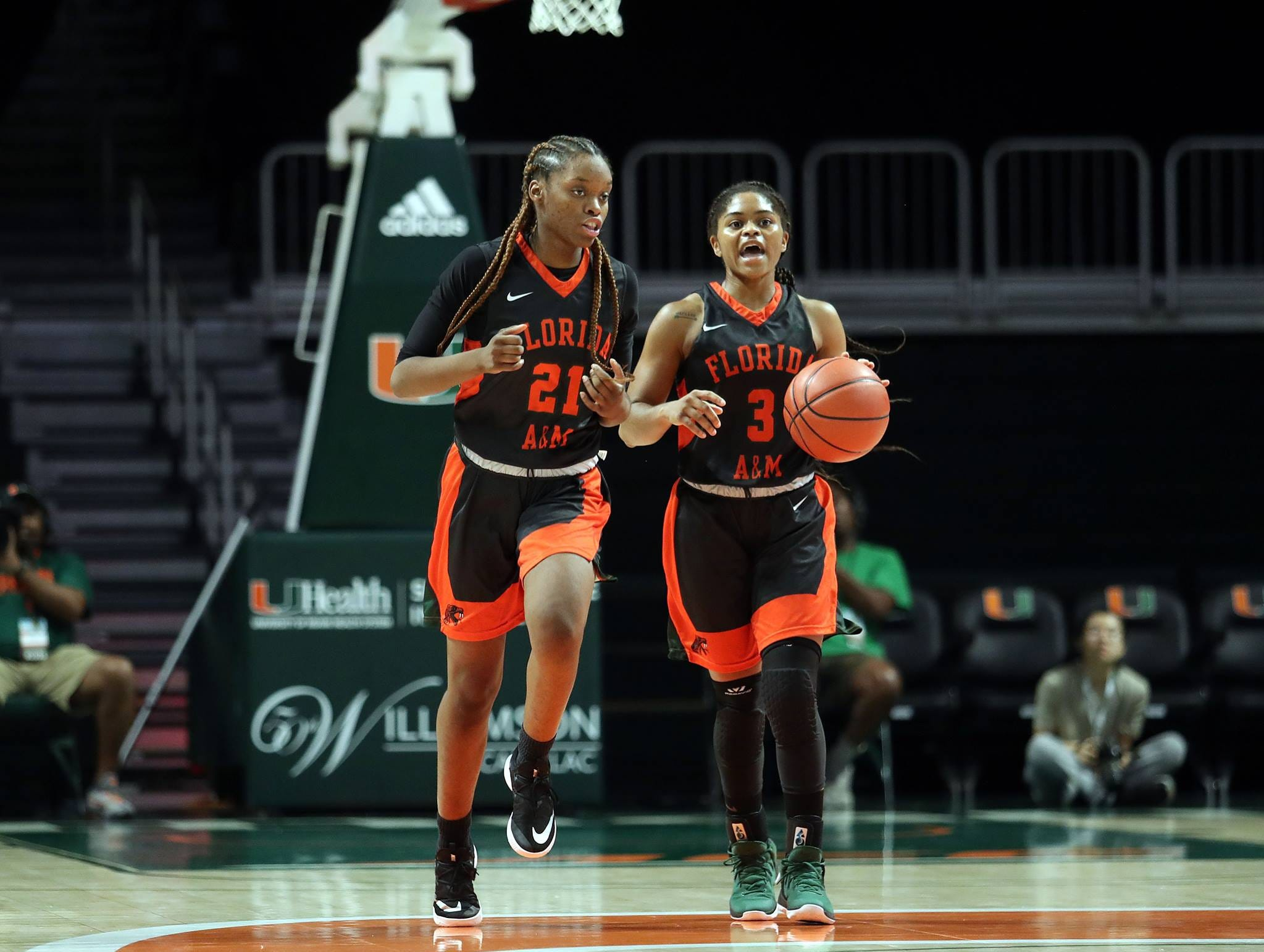 FAMU point guard Candice Williams (3) brings the ball up court alongside Keziah Dilworth in the Miami Holiday Classic.