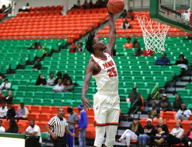 FAMU's D.J. Jones leaps skyward for a dunk in the win over Fort Valley State.