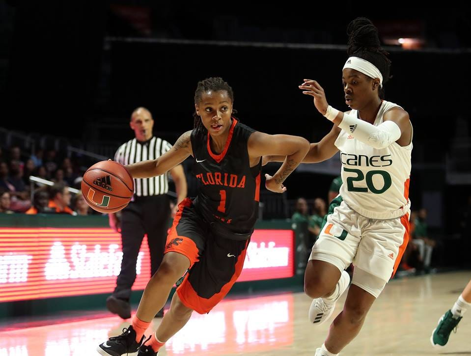 FAMU freshman guard Mya Moye drives by Kelsey Marshall in the Miami Holiday Classic. Moye scored a team-high 18 points in the game.
