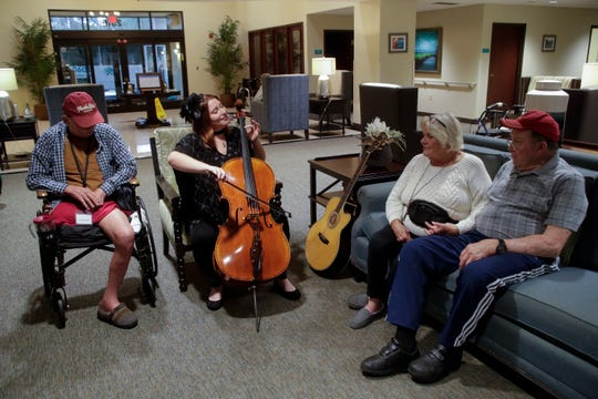 Lauren Mullinax, center, plays cello for Russell Wallace, 71, left, Carolyn Riggs, 74, right and Jim Wilson, 77, all residents at Tapestry Senior Living in Tallahassee Friday, Jan. 4, 2019.