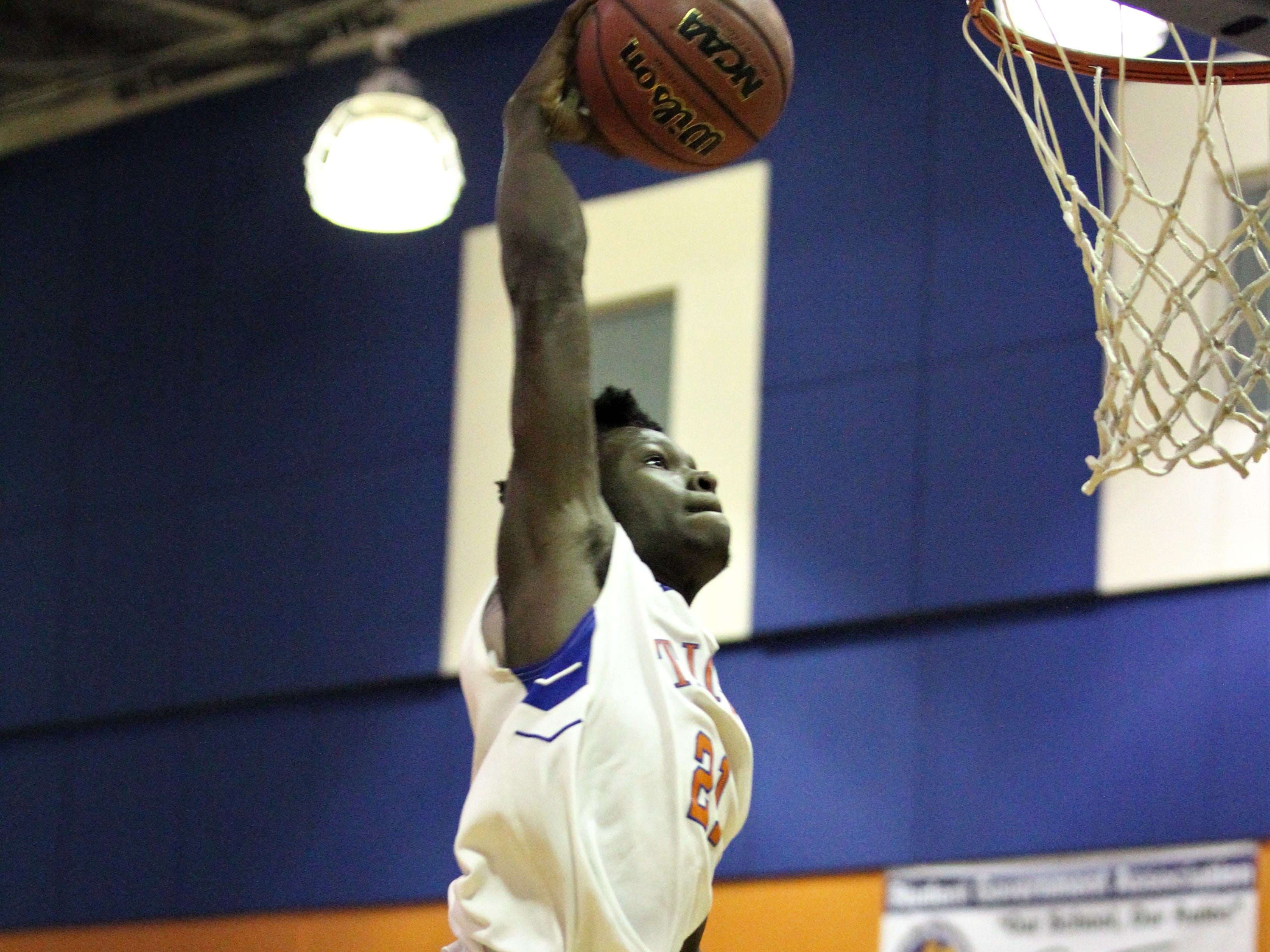 Jefferson County's Detrevian Nealy goes up for a dunk as Madison County won 70-44 at Jefferson County on Jan. 3, 2019.