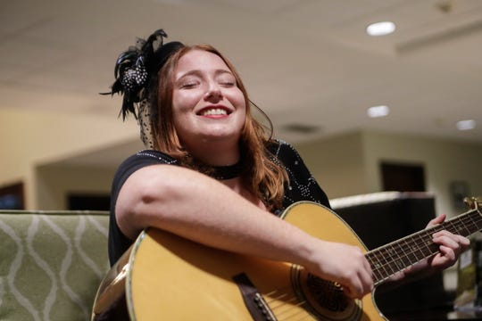 Lauren Mullinax plays guitar for residents at Tapestry Senior Living in Tallahassee Friday, Jan, 4, 2019.