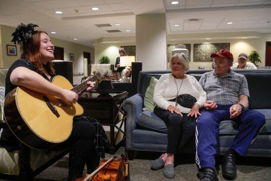 Carolyn Riggs, 74, and Jim Wilson, 77, listen as Lauren Mullinax plays guitar for residents at Tapestry Senior Living in Tallahassee Friday, Jan, 4, 2019.