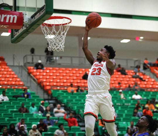 FAMU's Bryce Moragne goes up for a dunk against Fort Valley State on Dec. 6, 2018.  The Rattlers beat the Wildcats 80-58 at the Al Lawson Multipurpose Center.