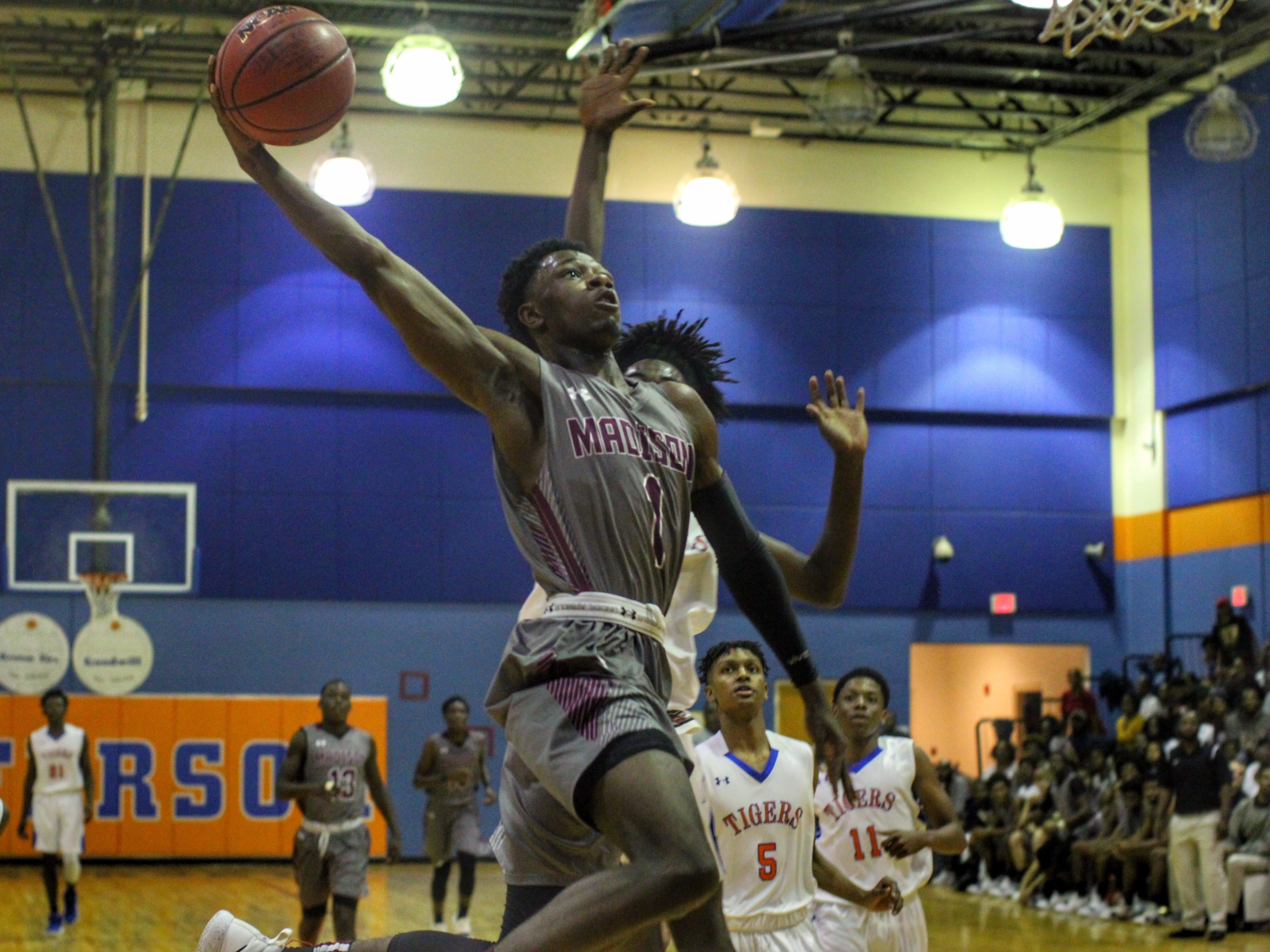 Madison County's Vincenta Mitchell soars in for a dunk attempt in a win over Jefferson County on Jan. 3, 2019.