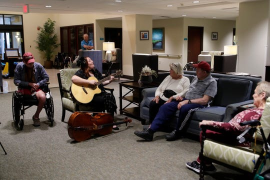 Russell Wallace, 71, left, Carolyn Riggs, 74, Jim Wilson, 77 and Kay Gluesenkamp, 77, listen as Lauren Mullinax, center, plays guitar for residents at Tapestry Senior Living in Tallahassee Friday, Jan, 4, 2019.