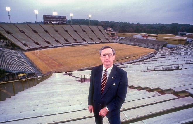 Historic photo of George Langford, president of Municipal Code Corp on Capitol Circle in Tallahassee, Florida December 13, 1983.  Langford is in Doak Campbell Stadium on the FSU campus.