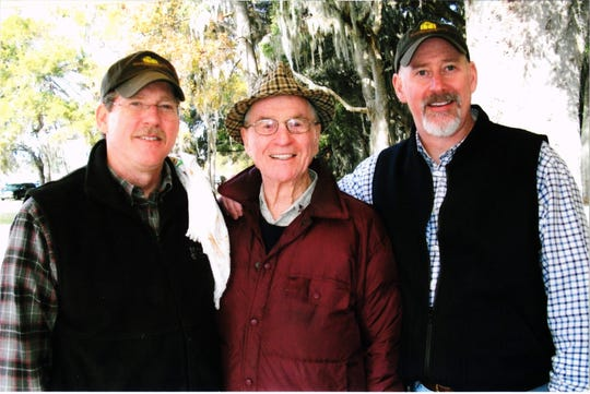 George Langford flanked by his sons Lawton (L) and George Jr. (R)