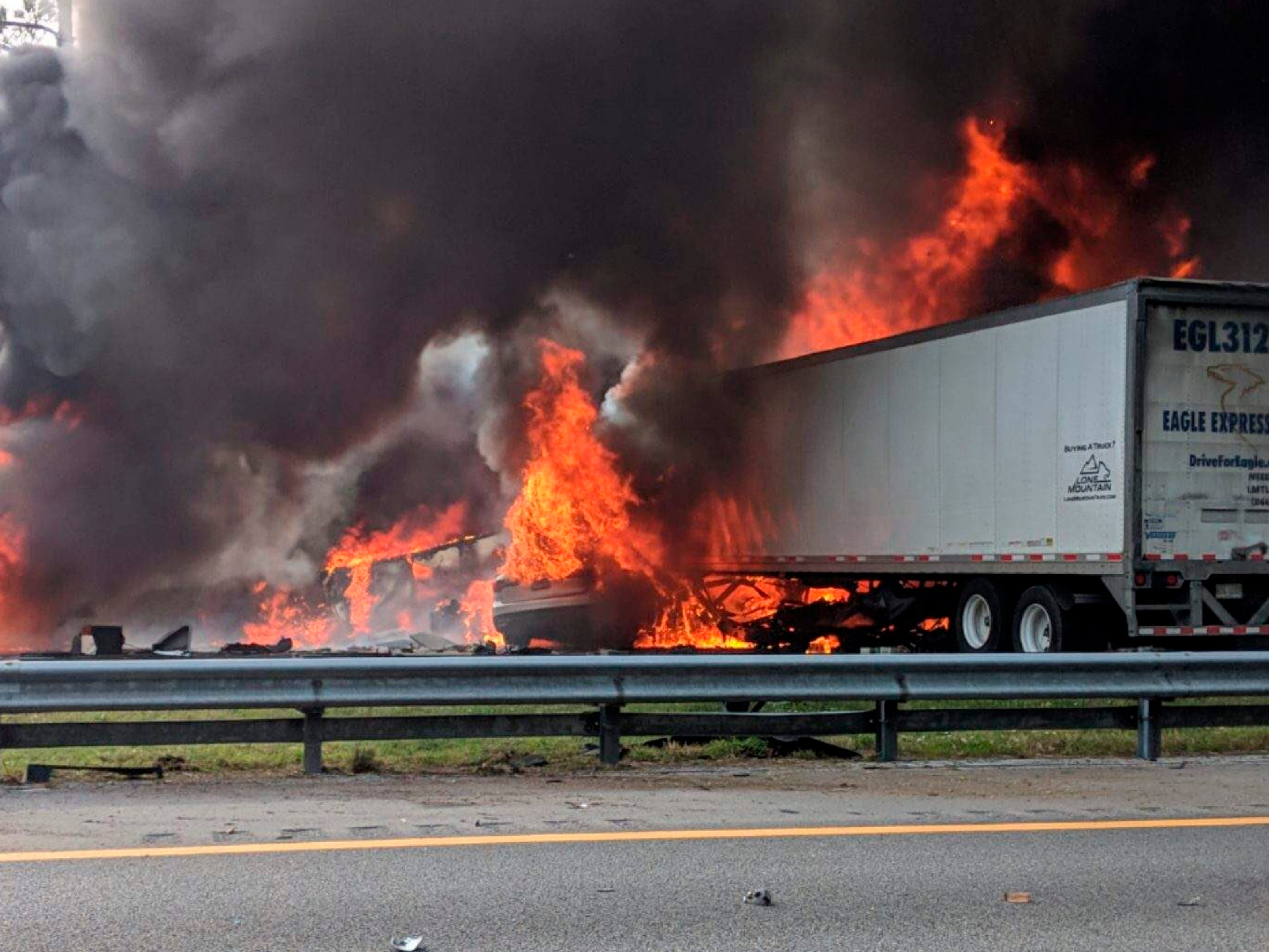 This image taken from a Florida 511 traffic camera and provided by the Alachua County Fire Rescue, shows a fiery crash along Interstate 75, Jan. 3, 2019, about a mile south of Alachua, near Gainesville. The crash killed seven people and injured several others. A diesel fuel spill sparked a massive fire on the interstate.