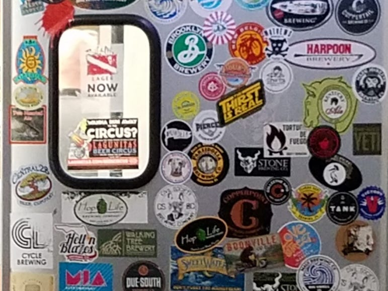 Castaways Gastropub is located at 911 N.E. Jensen Beach Blvd. The door to the kitchen is covered with beer logos.