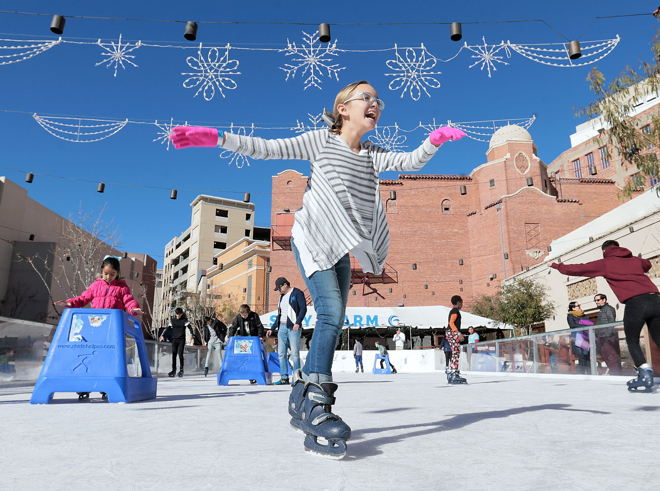 Paula Aguila, 10, enjoys the skating rink at WinterFest on Friday afternoon. It is the final weekend to enjoy WinterFest in Downtown El Paso. The event sponsored by the Hospitals of Providence features ice skating, holiday shopping and other special events. WinterFest is located in Arts Festival Plaza.