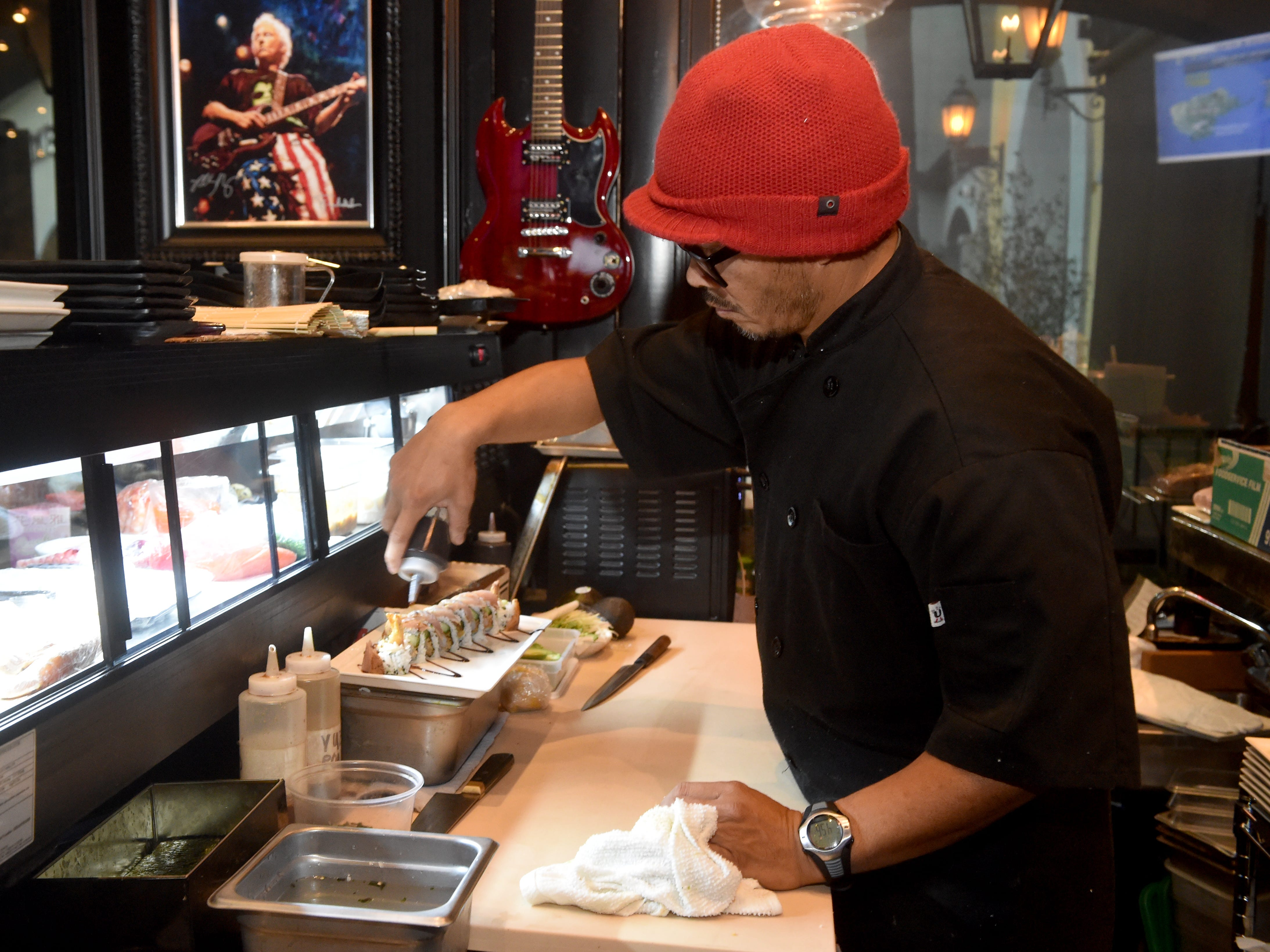 Ariel Guico prepares a Maui Wowie sushi roll at The Park Restaurant and Bar in Oak Park.