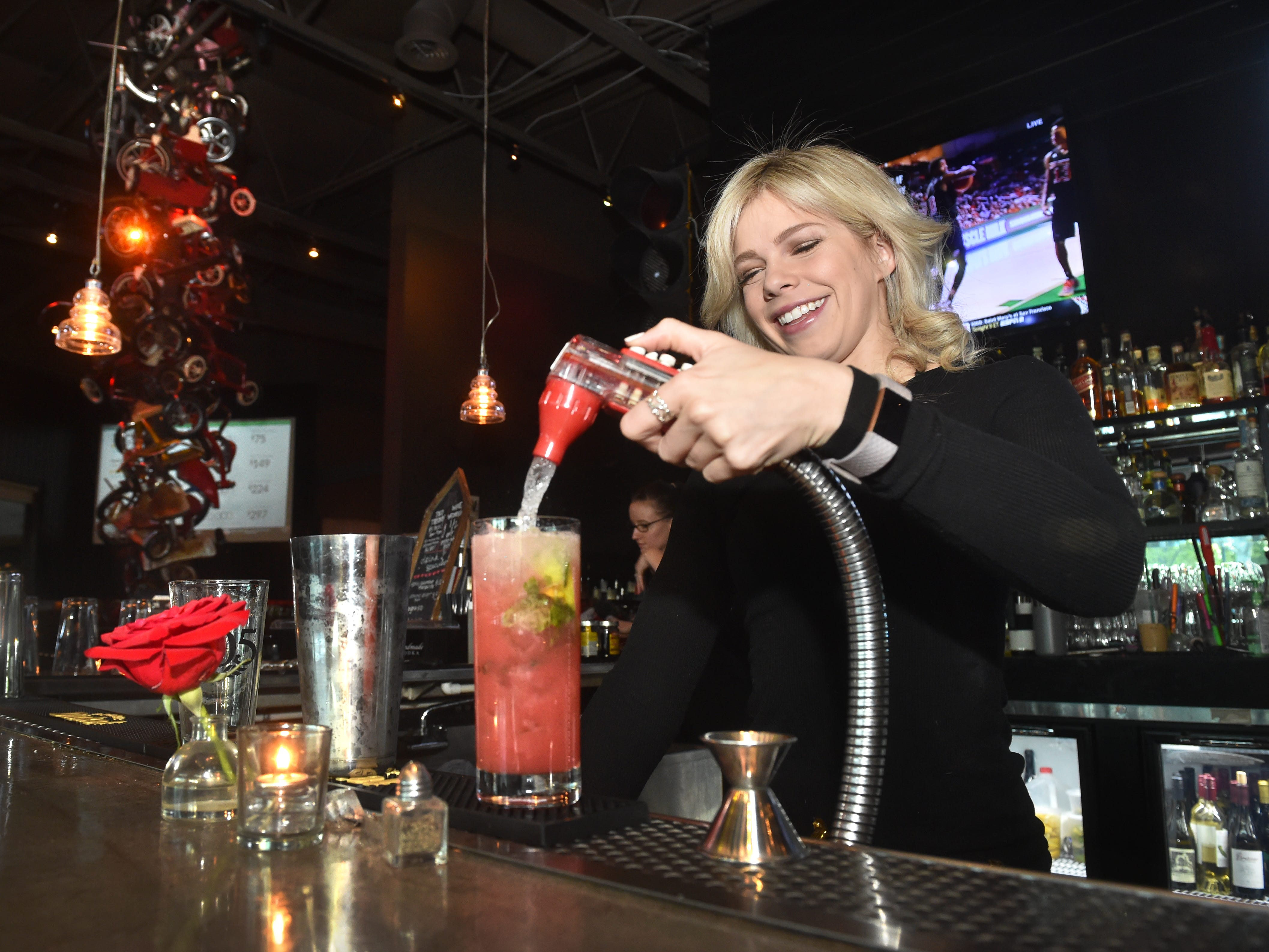 Katie Ray, the bar manager at The Park Restaurant and Bar in Oak Park, mixes a cocktail at the bar on Thursday.