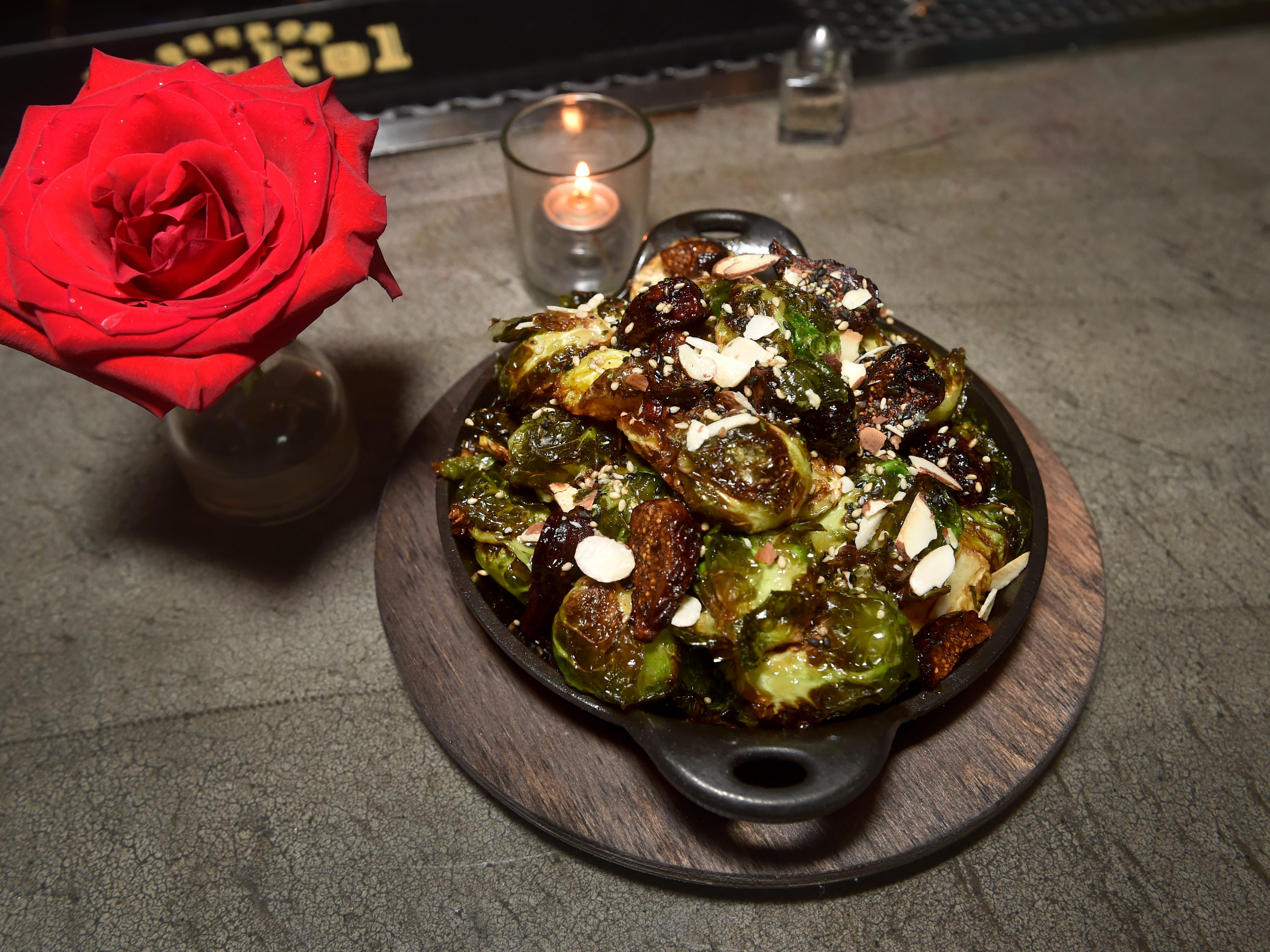 Among the appetizers at The Park Restaurant and Bar in Oak Park is a plate of brussel sprouts with black mission figs and an almond sesame turikake.