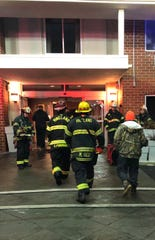 Firefighters escorted displaced guests into the Holiday Inn Express in Vineland to retrieve their belongings after a fire on Jan. 3, 2019.