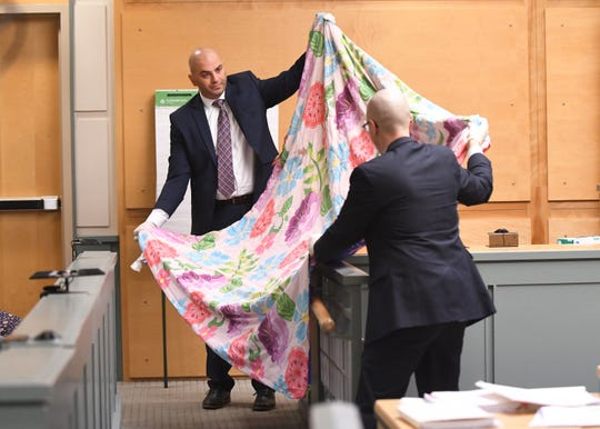 New Jersey State Police Detective Michael Hughes (left) and County Assistant Prosecutor Charles Wettstein show jurors the blanket that Tara O'Shea-Watson's body was found in during trial in Cumberland County Superior Court on Thursday, January 3, 2019.
