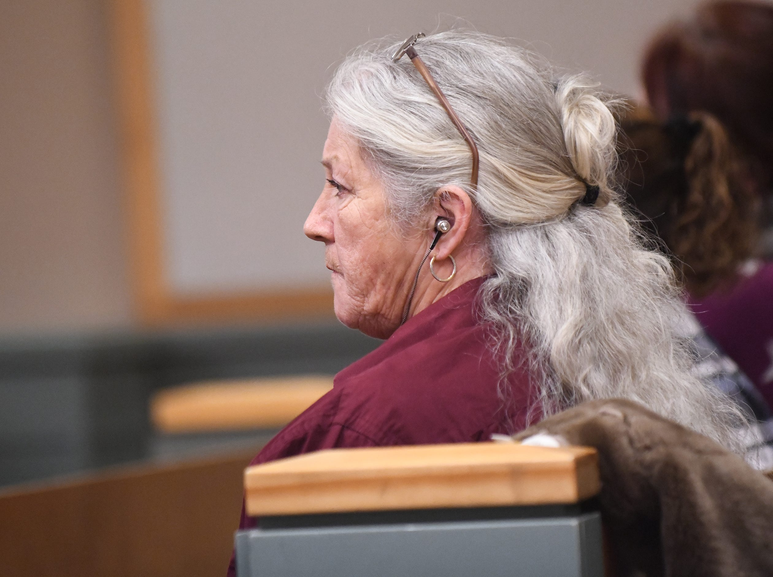 Family members of the late Tara O'Shea-Watson, who was killed inside her Commercial Township home in 2016, listen to testimony on Thursday, January 3, 2019.
