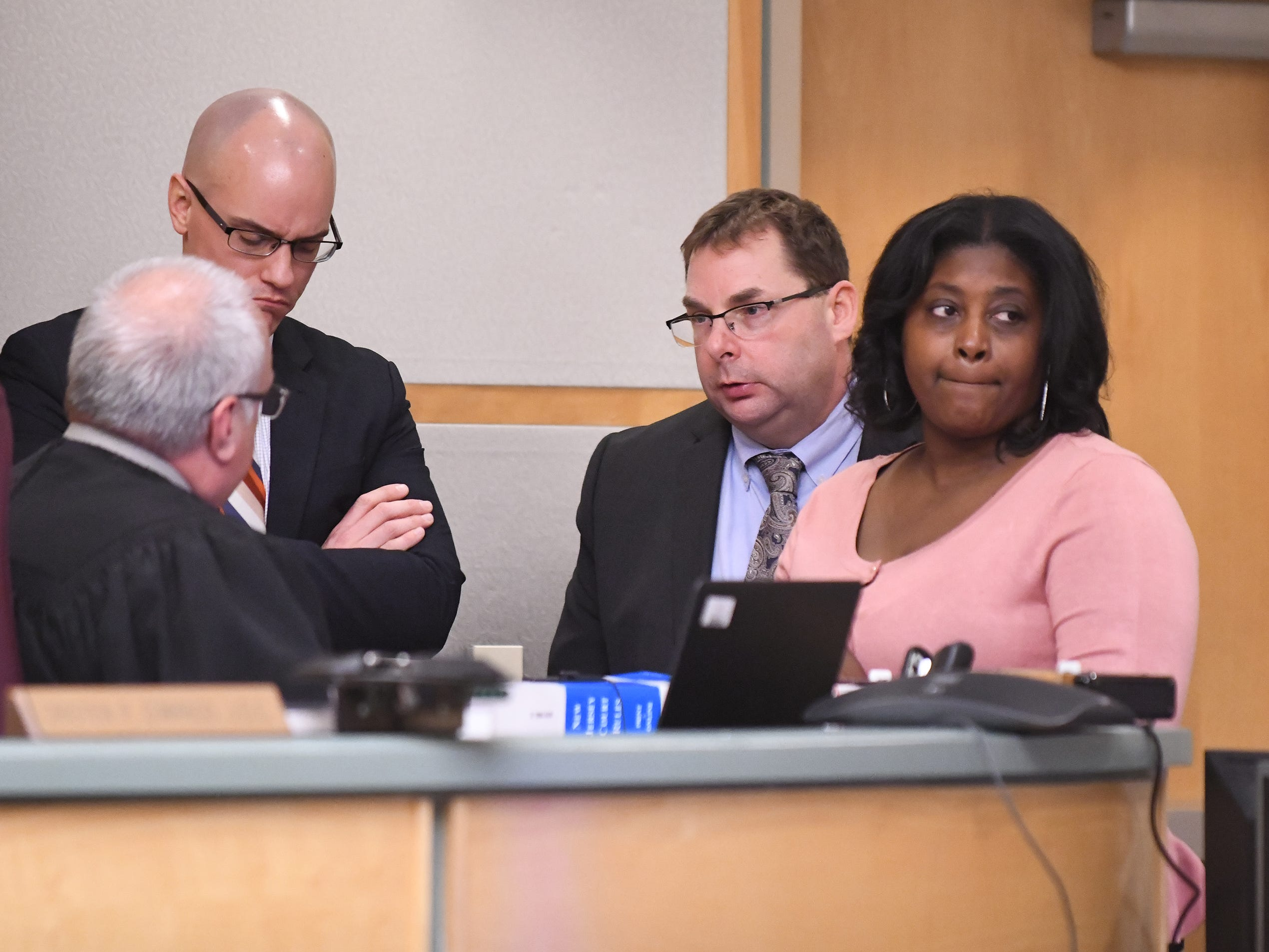 County Assistant Prosecutor Charles Wettstein (left) and defense attorneys Nathan Perry and JoEllyn Jones, listen to Judge Cristen D'Arrigo during the murder trial of Jeremiah E. Monell on Thursday, January 3, 2019.