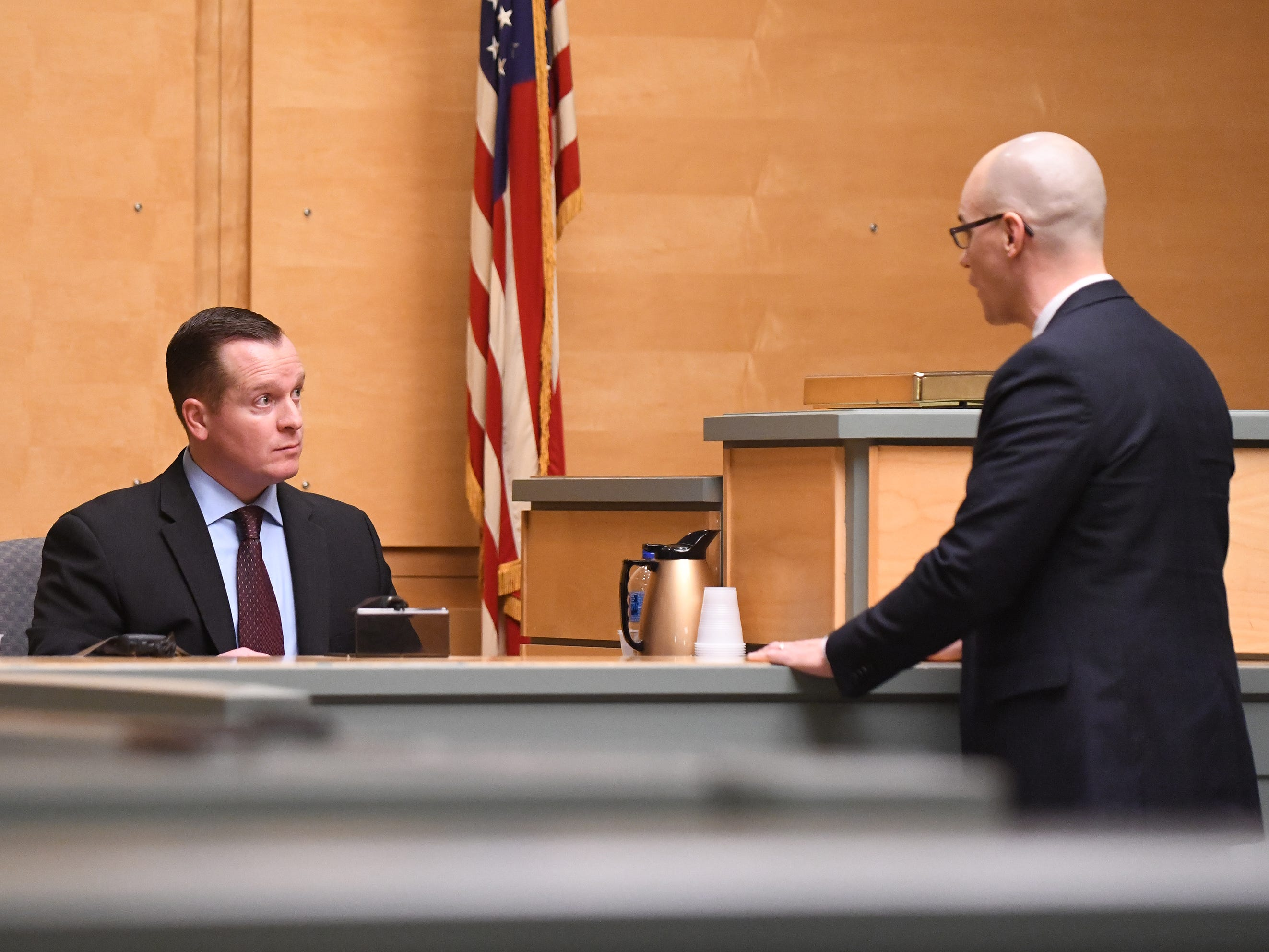 County Assistant Prosecutor Charles Wettstein (right) speaks with New Jersey State Police detective Sgt. Eric Crain regarding crime scene photos during trial on Thursday, January 3, 2019.