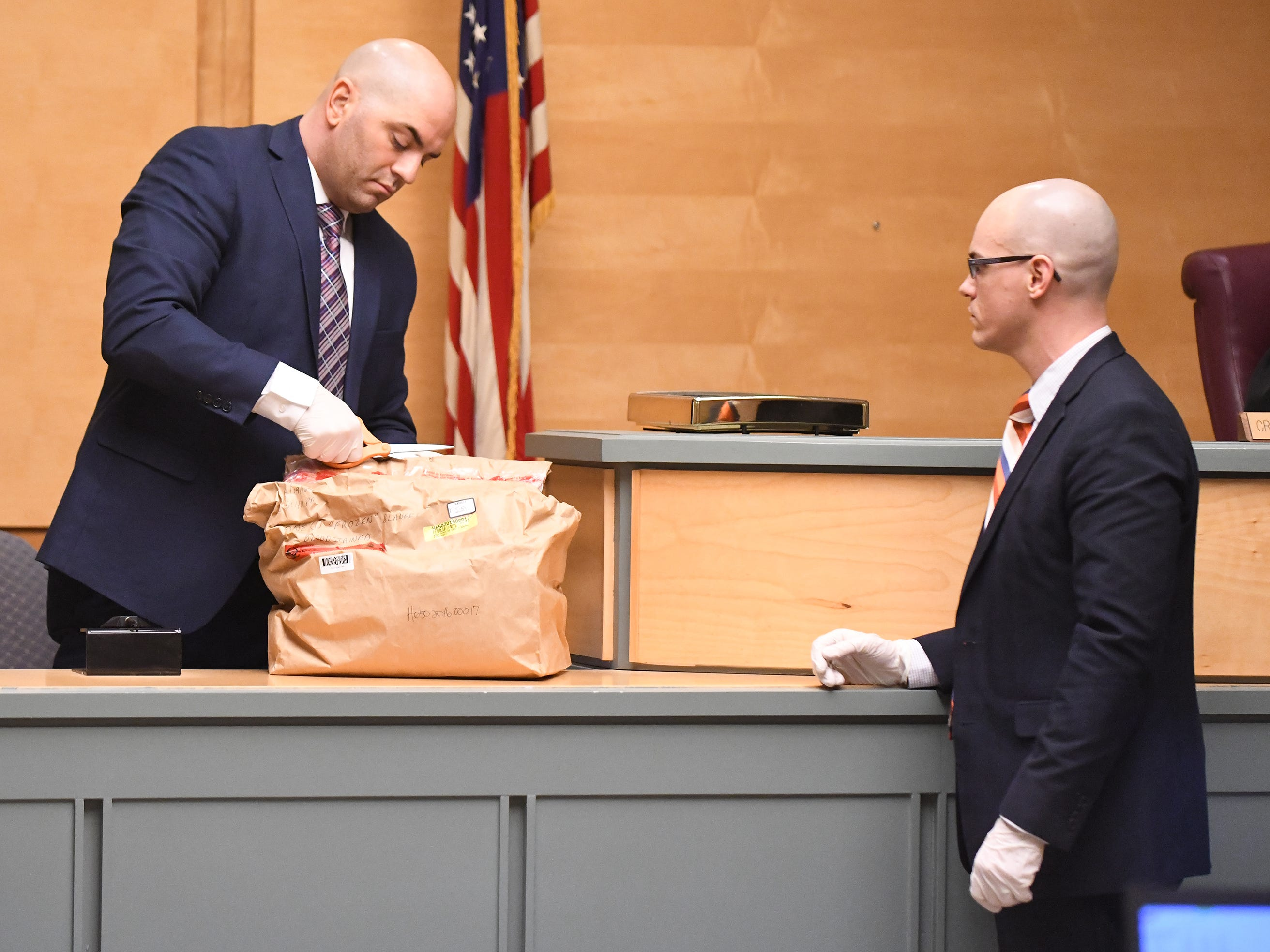 New Jersey State Police Detective Michael Hughes (left) and County Assistant Prosecutor Charles Wettstein prepare to show jurors the blanket that Tara O'Shea-Watson's body was found in during trial in Cumberland County Superior Court on Thursday, January 3, 2019.