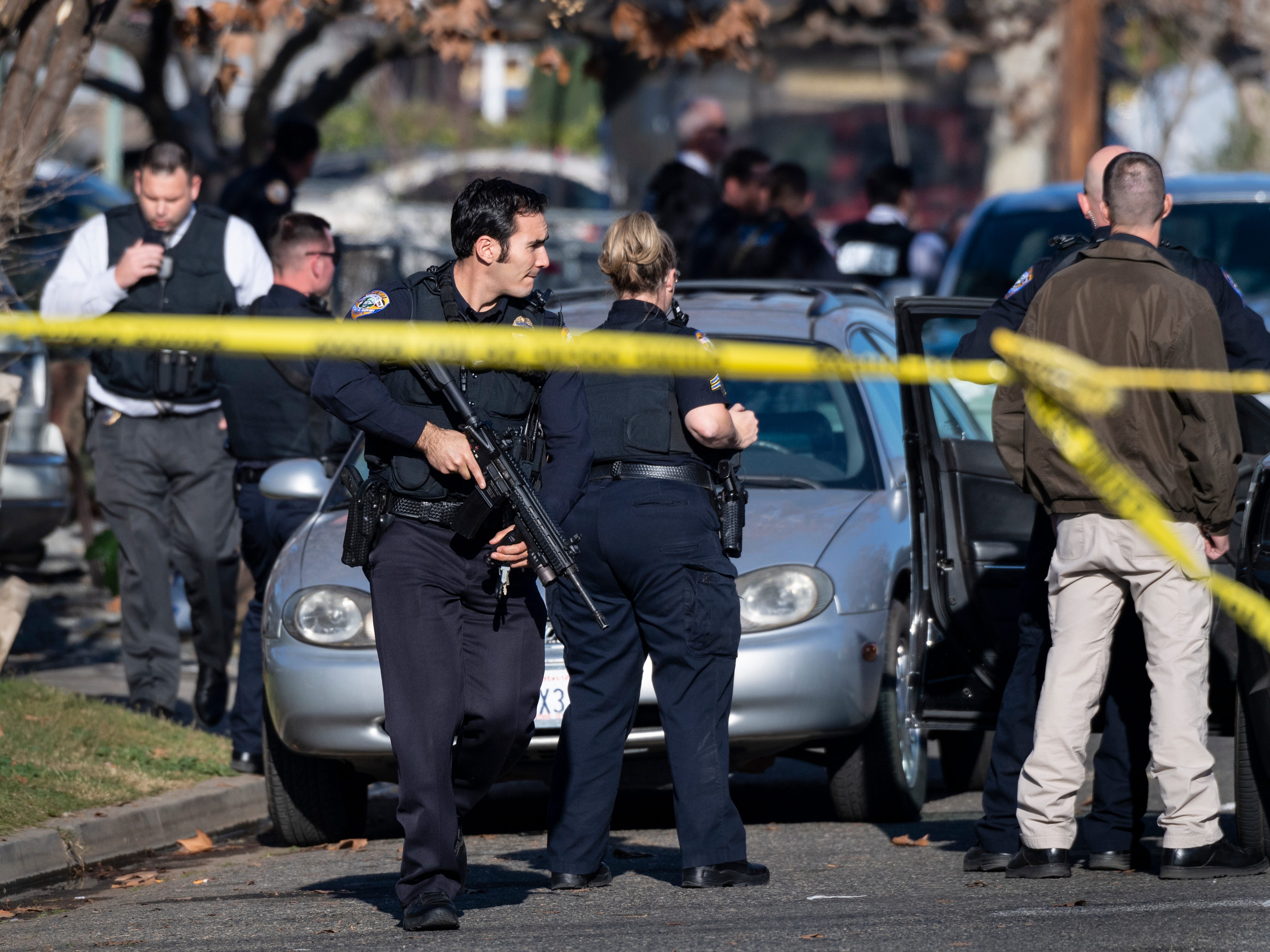 Visalia Police officers respond to a shooting in the 200 block of N.E. 4th Street on Thursday, January 3, 2019.
