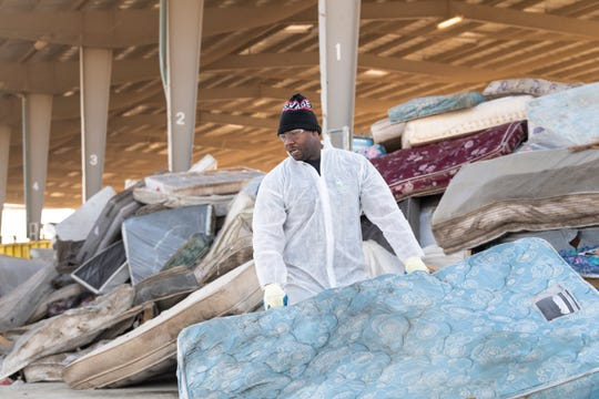 Rest In Peace Recycling employee Gregory Gibson loads discarded mattresses at the Tulare County  on Friday, January 4, 2019. More than 100 are disposed here every week.
