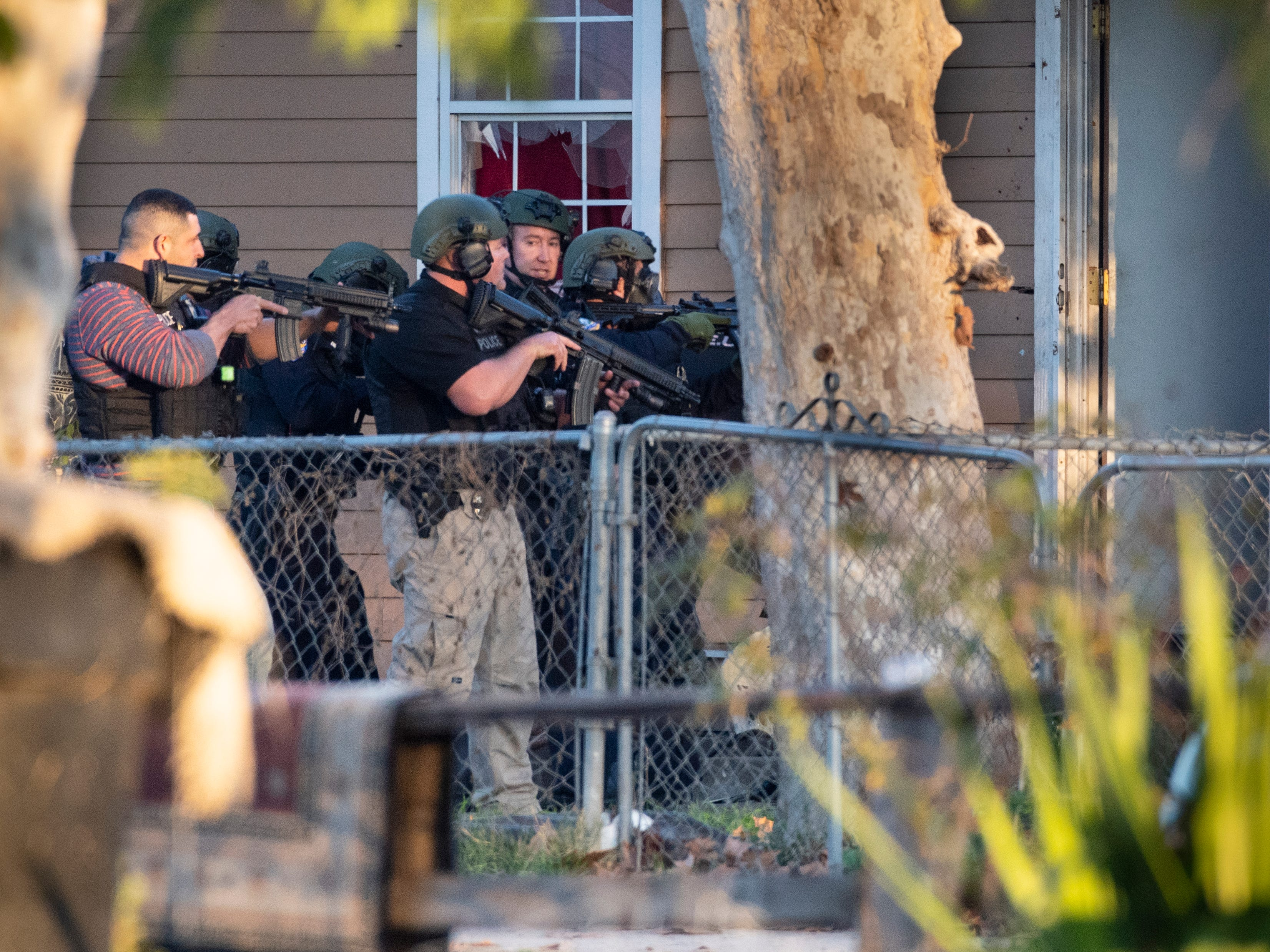 Visalia Police SWAT officers respond to a shooting in the 200 block of N.E. 4th Street on Thursday, January 3, 2019.