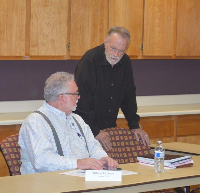Dan Heckathorne, left. and Kevin Northcraft, Tulare hospital board president. talk before the Thursday meeting.