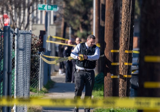 Visalia Police officers respond to a shooting in the 200 block of N.E. 4th Street on Thursday, January 3, 2019. The tea was blocked to traffic and pedestrians for hours while police attempted to take a shooting suspect into custody.
