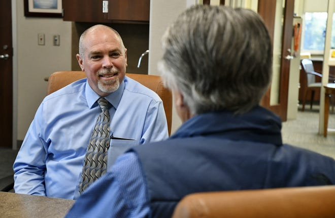 Tulare County Superintendent of Schools Elect Tim Hire speaks with Jim Vidak, recently retired Superintendent of Schools, on Thursday, January 3, 2019.