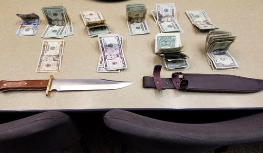 """When deputies arrived, witnesses told them a man walked into the businessarmed with a large """"Rambo"""" knife."""