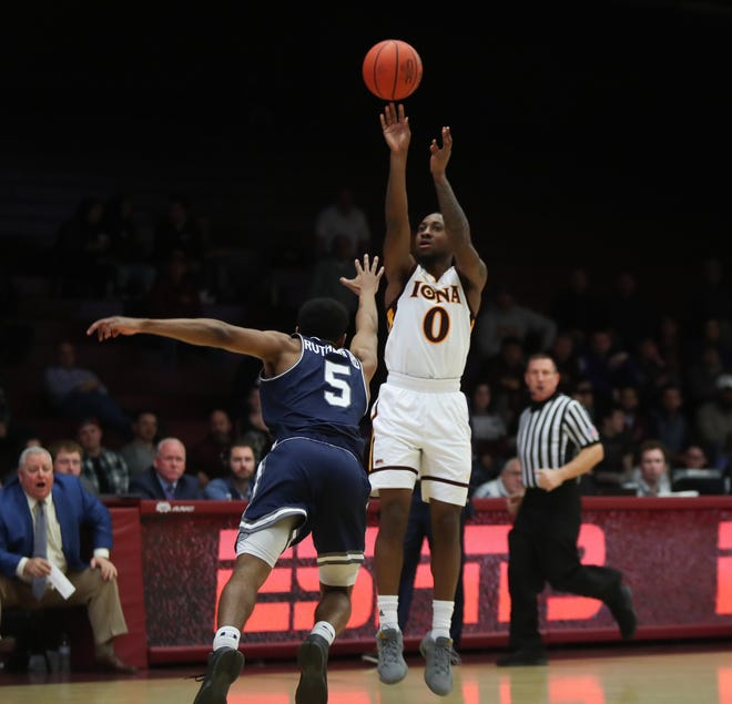 Iona guard Rickey McGill (0) puts a shot over Monmouth guard Nick Rutherford (5) during the MAAC league men's basketball game at the Hynes Center at Iona College in New Rochelle on Thursday, January 3, 2019.