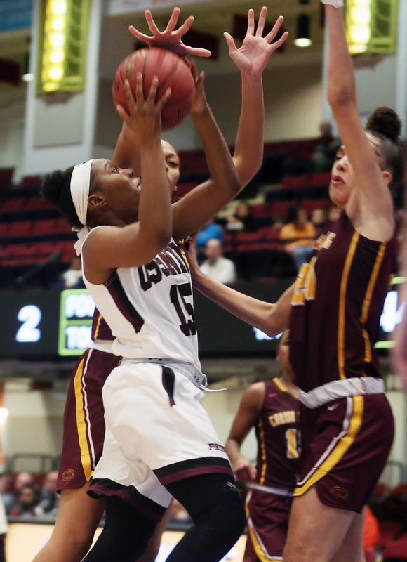 Ossining's Adriana McFadden (15) has her shot blocked by Christ the King's Klarke Scanners (25) during first half action in the first game of the Crusader Classic at the Westchester County Center in White Plains Jan. 4, 201. Christ the King won the game 91-50.