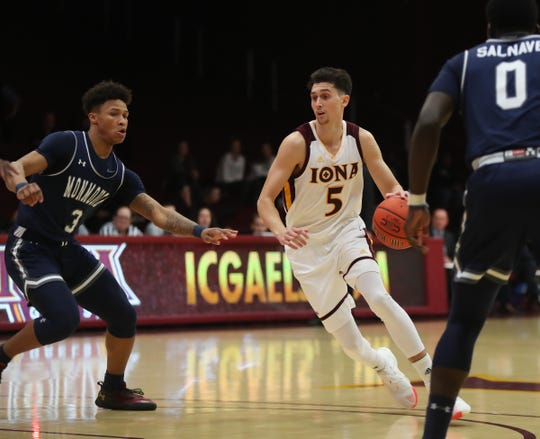 Iona guard Ben Perez (5) drives on Monmouth forward Deion Hammond (3) during the MAAC league men's basketball game at the Hynes Center at Iona College in New Rochelle on Thursday, January 3, 2019. Perez is currently out with an ankle injury.