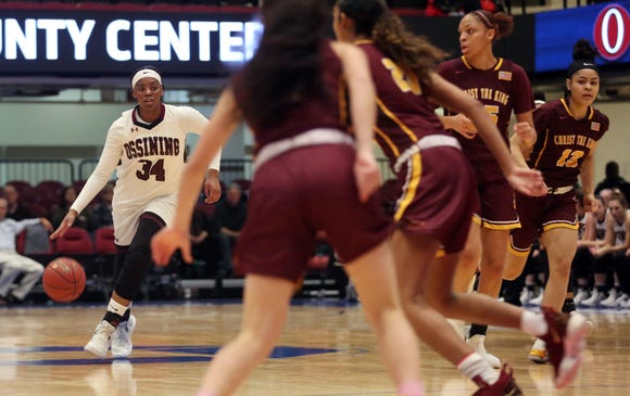 Ossining's Kailah Harris (34) tries to find away around the Christ the King defense in the first game of the Crusader Classic at the Westchester County Center in White Plains Jan. 4, 201. Christ the King won the game 91-50.
