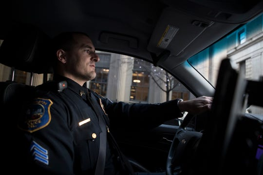 Sgt. Matt Rosario with the Wilmington Police Department drives down Market Street during a ride-a-long with members of the News Journal in the Wednesday, Dec. 5, 2018.
