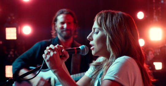 "Bradley Cooper, left, and Lady Gaga star in ""A Star is Born."""