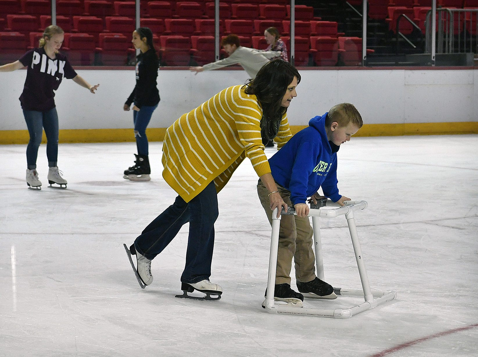 Less-experienced skaters took advantage of sliding support frames during the First Bank Open Skate event Friday afternoon at Key Yeager Coliseum.