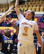 Junior Mica Schneider leaps for the ball. The Mustangs lost to A&M Commerce with a score of 70-57 tonight.